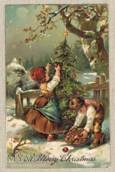 1908 Dwoje dzieci ubiera choinkę