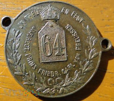 Medal mocowany do dewizki zegarka.