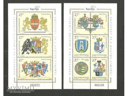 Węgierskie znaczki z herbami komitatów.