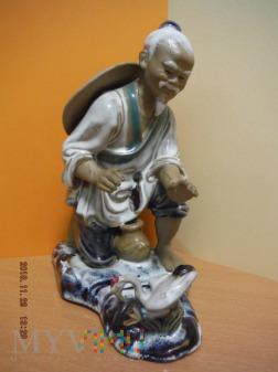 chińczyk z ptakiem
