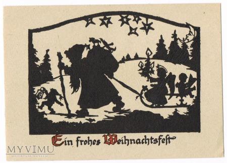 Mikołaj ciągnący sanie z gnomami
