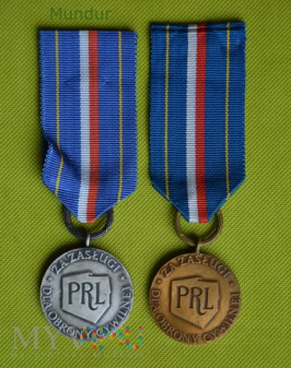 Odznaka za Zasługi dla OC - srebrna i brązowa