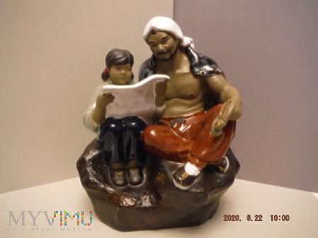 Chińczyk z czytającą dziewczynką