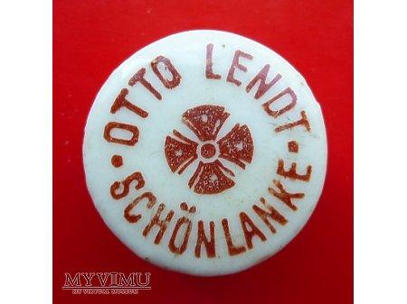 OTTO LENDT-okrągła .czerwony napis.