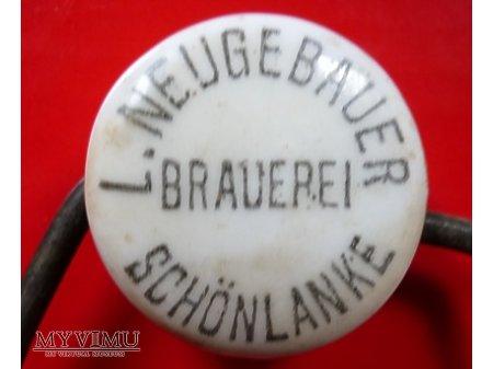 Ludwig Neugebauer-okrągła,czarny napis.