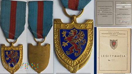 Złota Odznaka Gryfa Pomorskiego.