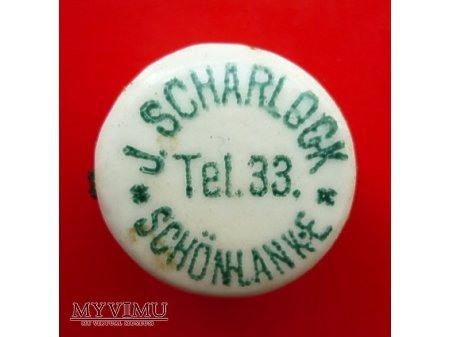 Scharlock Johann-okrągła,zielony napis.