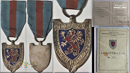 Srebrna Odznaka Gryfa Pomorskiego.