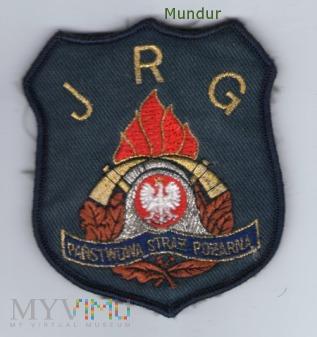 Emblemat PSP na podkładce granatowej