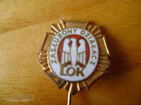 złota odznaka Zasłużony Działacz LOK