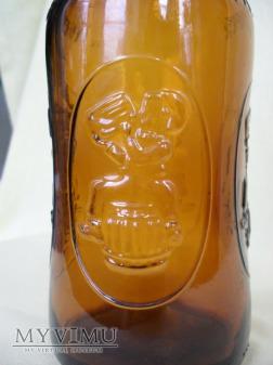 "Butelka szklana po piwie ""FISCHER"" - kabłąkowa"