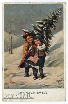 G. Ostoja Wesołych Świąt dzieci z choinką
