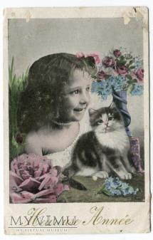 Noworoczne kocisko i dziewczynka pocztówka France